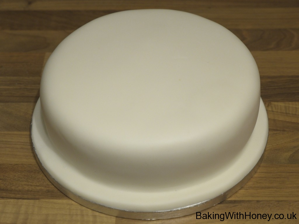 applying marzipan and icing to a cake: a step by step guide